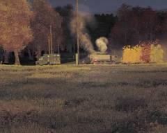 Wrak BRDM i płonący załogant